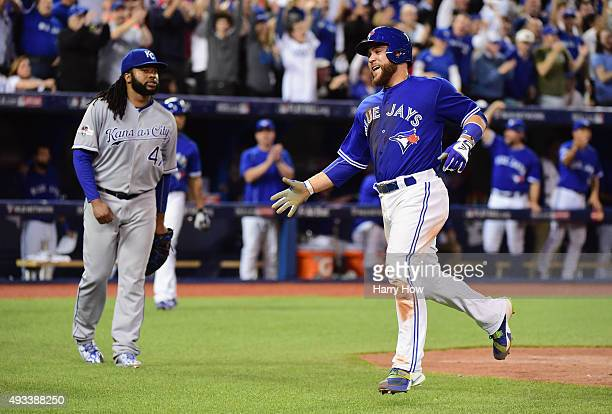 Russell Martin of the Toronto Blue Jays celebrates after scoring a run in the third inning against the Kansas City Royals during game three of the...