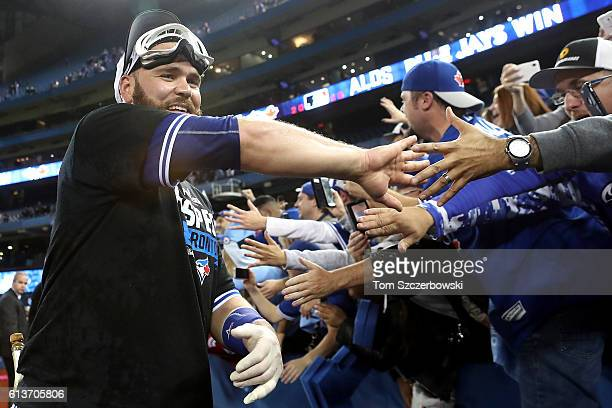Russell Martin of the Toronto Blue Jays celebrates with fans after the Toronto Blue Jays defeated the Texas Rangers for game three of the American...