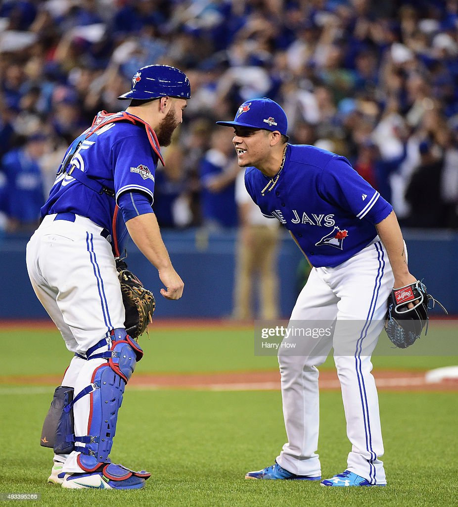 Russell Martin #55 of the Toronto Blue Jays celebrates with Roberto Osuna #54 of the Toronto Blue Jays after defeating the Kansas City Royals 11-8 in game three of the American League Championship Series at Rogers Centre on October 19, 2015 in Toronto, Canada.