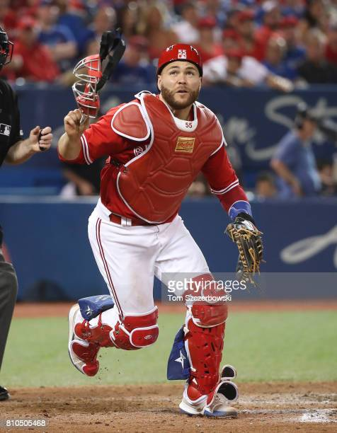 Russell Martin of the Toronto Blue Jays chases a pitch in the dirt that got away from him in the ninth inning during MLB game action against the...