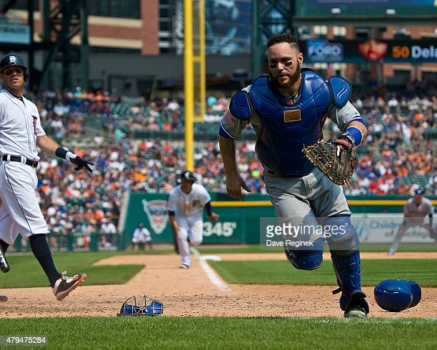 Russell Martin of the Toronto Blue Jays chases after a wild pitch during a MLB game against the Detroit Tigers at Comerica Park on July 4 2015 in...