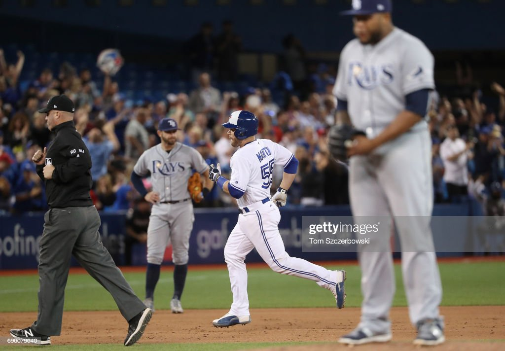Russell Martin #55 of the Toronto Blue Jays circles the bases after hitting a solo home run in the eighth inning during MLB game action as Jose Alvarado #46 of the Tampa Bay Rays reacts at Rogers Centre on June 14, 2017 in Toronto, Canada.