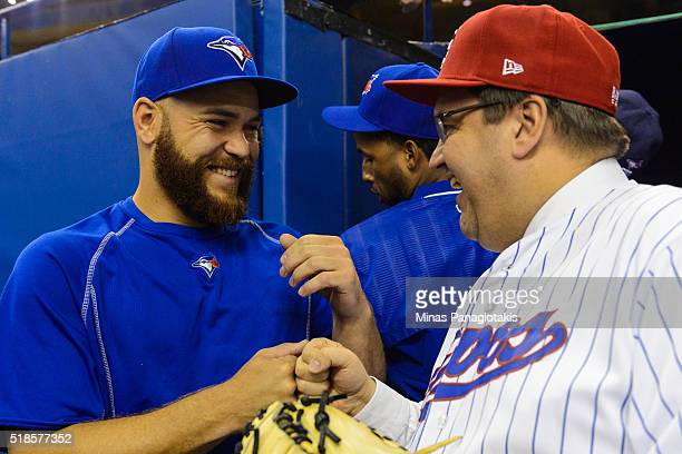 Russell Martin of the Toronto Blue Jays fist bumps with Montreal Mayor Denis Coderre prior to the MLB spring training game against the Boston Red Sox...