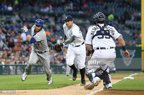 Russell Martin of the Toronto Blue Jays gets caught leading off third base and is tagged out by Nick Castellanos of the Detroit Tigers during the...