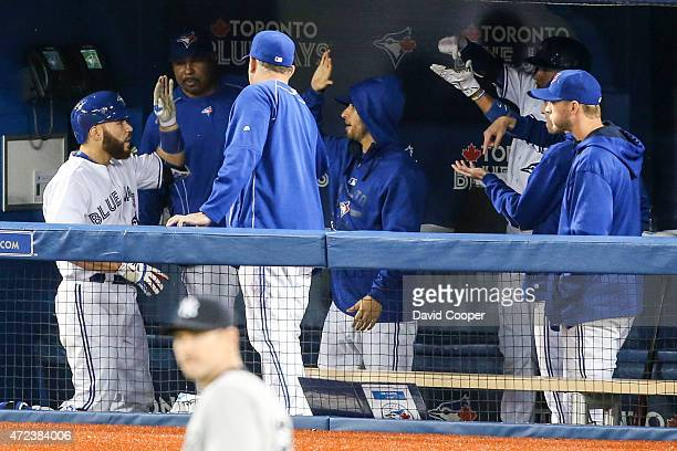 TORONTO ON MAY 6 Russell Martin of the Toronto Blue Jays gets high fives in the dugout after he crushes a home run to Left in the 6th inning during...