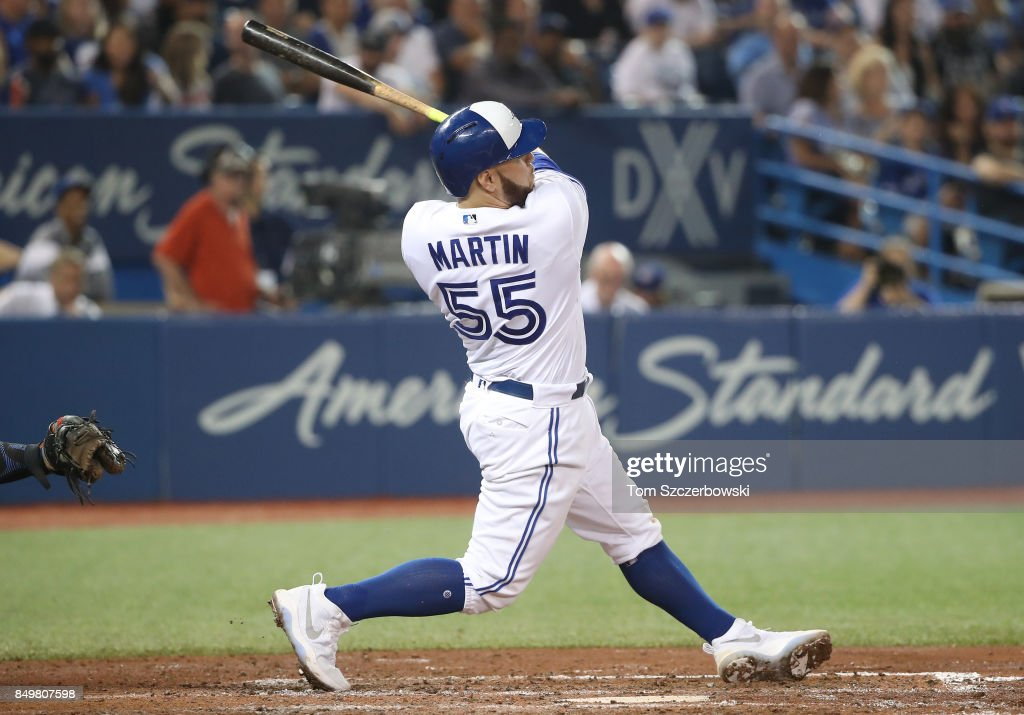 Russell Martin #55 of the Toronto Blue Jays hits a two-run double in the seventh inning during MLB game action against the Kansas City Royals at Rogers Centre on September 19, 2017 in Toronto, Canada.