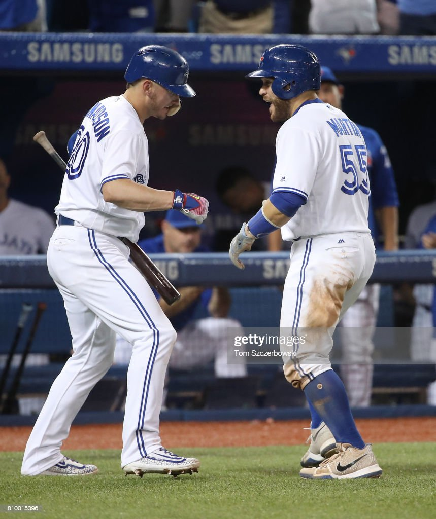 Russell Martin #55 of the Toronto Blue Jays is congratulated by Josh Donaldson #20 after hitting a solo home run in the sixth inning during MLB game action against the Houston Astros at Rogers Centre on July 6, 2017 in Toronto, Canada.