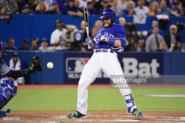 Russell Martin of the Toronto Blue Jays is hit by a pitch in the second inning against the Kansas City Royals during game three of the American...