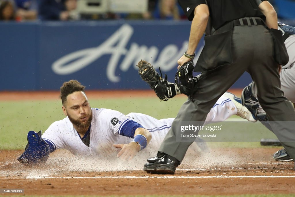 Russell Martin #55 of the Toronto Blue Jays is tagged out at home plate by Austin Romine #28 of the New York Yankees in the second inning during MLB game action at Rogers Centre on April 1, 2018 in Toronto, Canada.