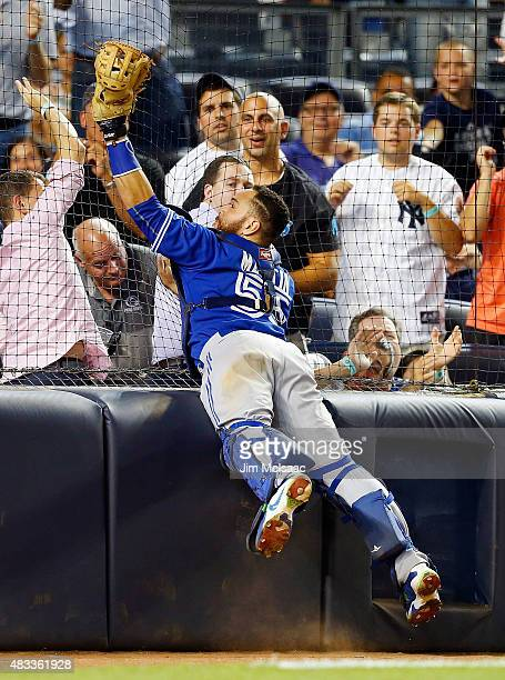 Russell Martin of the Toronto Blue Jays makes a catch on a foul ball hit by Stephen Drew of the New York Yankees in the seventh inning at Yankee...