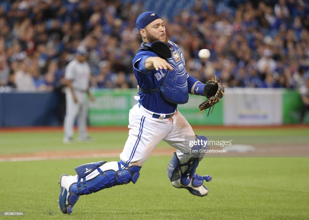 Russell Martin #55 of the Toronto Blue Jays makes the play and throws out the baserunner in the ninth inning during MLB game action against the Texas Rangers at Rogers Centre on April 29, 2018 in Toronto, Canada.