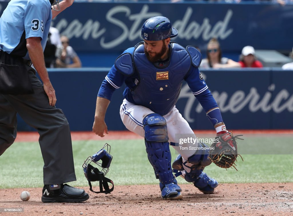 Russell Martin #55 of the Toronto Blue Jays pounces on a ball in the dirt that skipped away but the baserunner did not advance on the play in the seventh inning against the Atlanta Braves at Rogers Centre on June 20, 2018 in Toronto, Canada.
