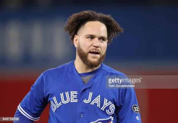 Russell Martin of the Toronto Blue Jays reacts after grounding into a double play to end the sixth inning during MLB game action against the Kansas...
