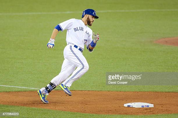 Russell Martin of the Toronto Blue Jays rounds 2nd after he crushes a home run to Left in the 6th inning during the game between the Toronto Blue...