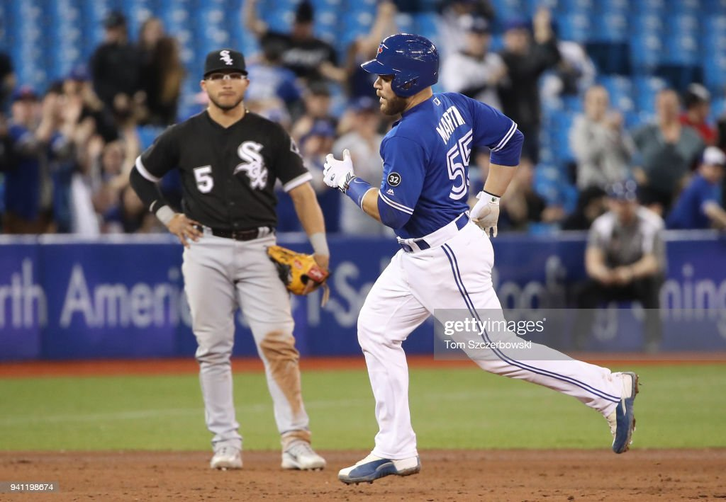 Russell Martin #55 of the Toronto Blue Jays rounds the bases on his two-run home run as Yolmer Sanchez #5 of the Chicago White Sox looks on in the seventh inning of MLB game action at Rogers Centre on April 2, 2018 in Toronto, Canada.