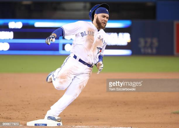 Russell Martin of the Toronto Blue Jays rounds third base and races home to score a run on an RBI single by Luke Maile in the eighth inning during...