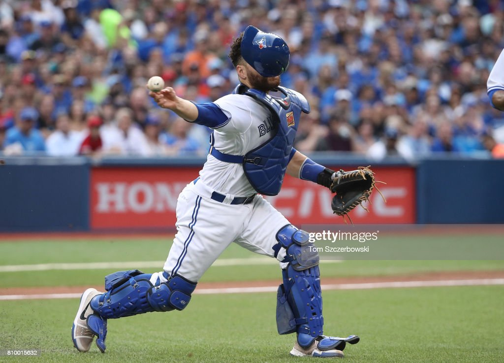 Russell Martin #55 of the Toronto Blue Jays throws out the baserunner after fielding a soft grounder in the second inning during MLB game action against the Houston Astros at Rogers Centre on July 6, 2017 in Toronto, Canada.
