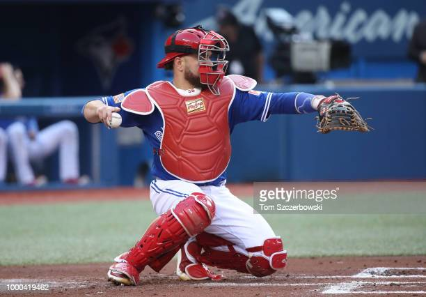 Russell Martin of the Toronto Blue Jays wears redthemed equipment on Independence Day as he catches behind home plate during MLB game action against...