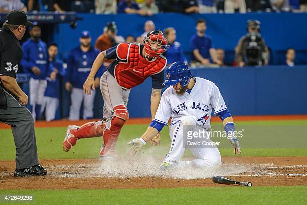 Russell Martin scores the Blue Jays 7th run ahead of the tag by Blake Swihart of the Boston Red Sox, on a hit by Ezequiel Carrera in the bottom of...