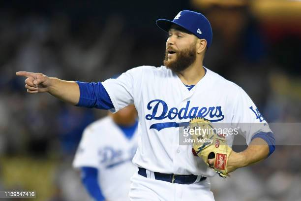 Russell Martin who usually plays catcher celebrates the final out against Arizona Diamondbacks at Dodger Stadium on March 30 2019 in Los Angeles...