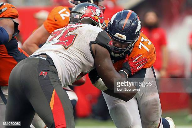 Russell Okung of the Broncos works on DaVonte Lambert of the Bucs during the NFL game between the Denver Broncos and Tampa Bay Buccaneers on October...