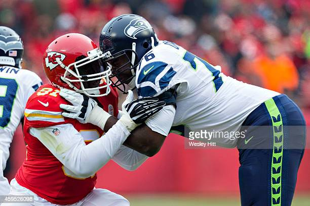 Russell Okung of the Seattle Seahawks blocks Tamba Hali of the Kansas City Chiefs during the first quarter at Arrowhead Stadium on November 16 2014...