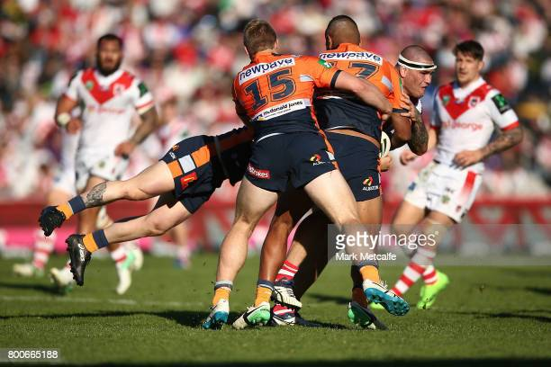 Russell Packer of the Dragons is tackled during the round 16 NRL match between the St George Illawarra Dragons and the Newcastle Knights at UOW...