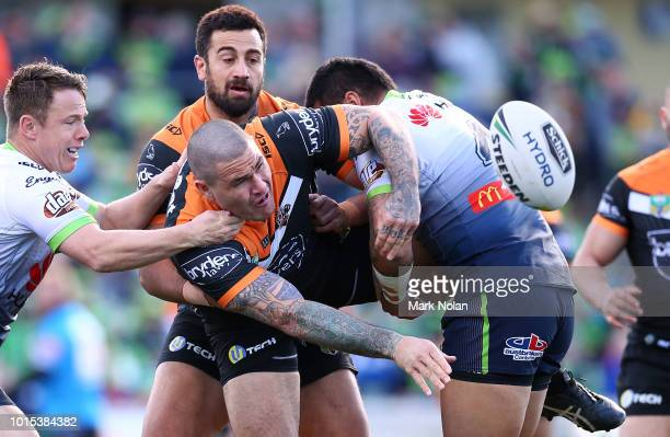 Russell Packer of the Tigers offloads during the round 22 NRL match between the Canberra Raiders and the Wests Tigers at GIO Stadium on August 12...
