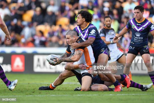 Russell Packer of the Tigers offloads the ball during the round five NRL match between the Wests Tigers and the Melbourne Storm at Mt Smart Stadium...