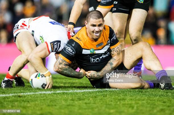 Jack de Belin of the Dragons surges forward during the round 23 NRL match between the Wests Tigers and the St George Illawarra Dragons at Leichhardt...