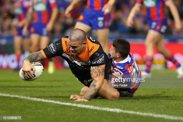 Russell Packer of the Tigers scores a try during the round 21 NRL match between the Newcastle Knights and the Wests Tigers at McDonald Jones Stadium...