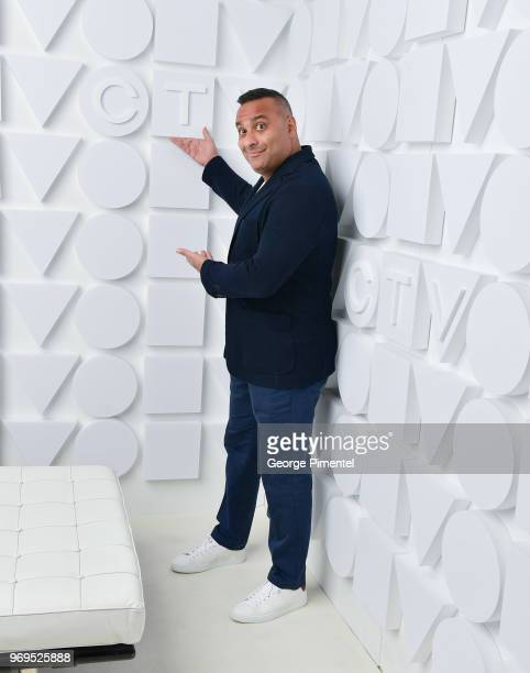 Russell Peters poses at the CTV Upfronts portrait studio held at the Sony Centre For Performing Arts on June 7 2018 in Toronto Canada