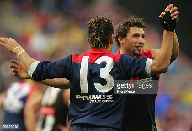 Russell Robertson and Adem Yze for the Demons celebrate a goal during the round twelve AFL match between The Melbourne Demons and the Collingwood...