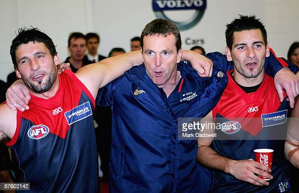 Russell Robertson Neale Daniher and Adem Yze of the Demons sing the club song after winning the round seven AFL match between the Melbourne Demons...