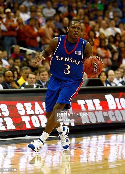 Russell Robinson of the Kansas Jayhawks dribbles the ball upcourt against the Texas Longhorns during the Big 12 Men's Basketball Tournament Finals on...