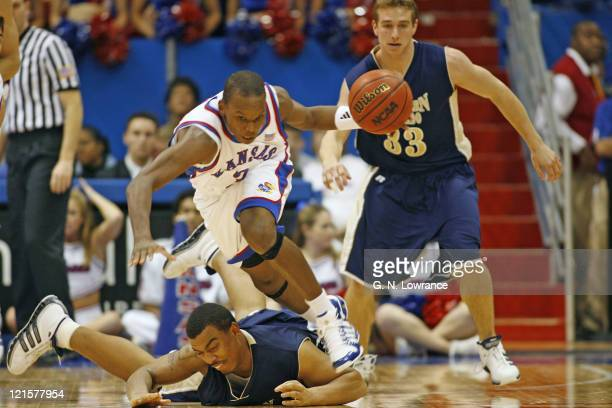 Russell Robinson of the Kansas Jayhawks makes a steal on Cory Lowe during 2ndhalf action against the Northern Colorado Bears at Allen Fieldhouse in...