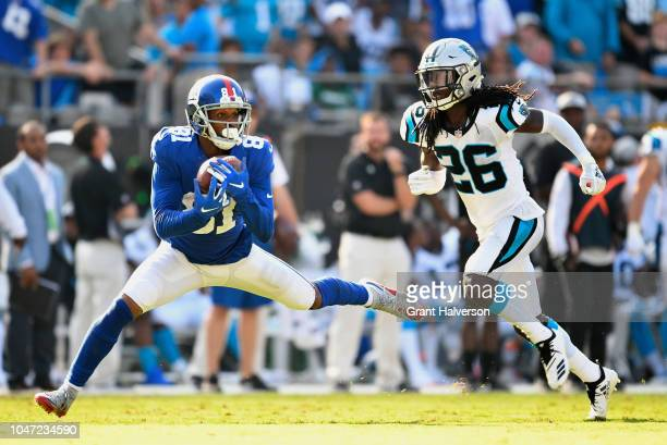 Russell Shepard of the New York Giants makes a catch against Donte Jackson of the Carolina Panthers during their game at Bank of America Stadium on...