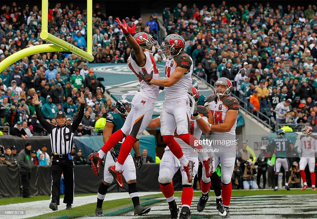 Russell Shepard #89 of the Tampa Bay Buccaneers celebrates his four-yard-touchdown catch in the second quarter with teammate Adam Humphries #11 against the Philadelphia Eagles at Lincoln Financial Field on November 22, 2015 in Philadelphia, Pennsylvania.