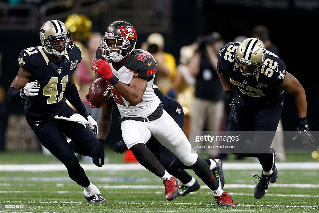 Russell Shepard #89 of the Tampa Bay Buccaneers is tackled by Roman Harper #41 of the New Orleans Saints at the Mercedes-Benz Superdome on December 24, 2016 in New Orleans, Louisiana.