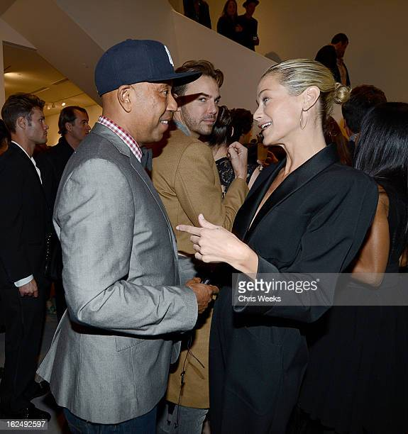 Russell Simmons and actress Carolyn Murphy attend a Private Reception For Mario Testino at PRISMon February 23 2013 in West Hollywood California