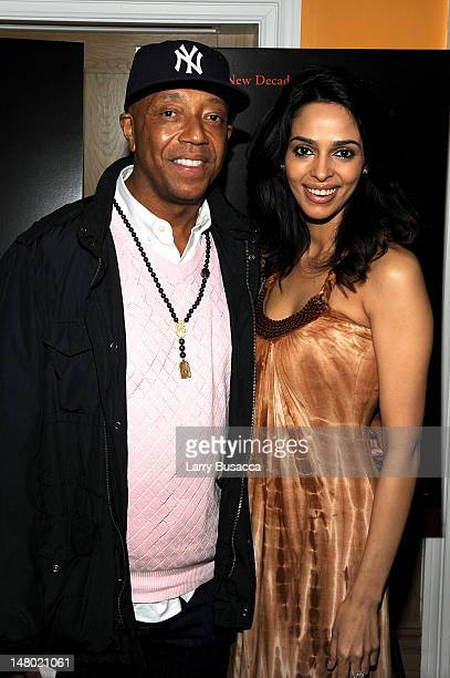 Russell Simmons and actress Mallika Sherawat attend the Scream 4 New York screening hosted by Curtis '50 Cent' Jackson Harvey Weinstein at the Crosby...