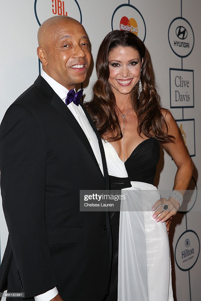 Russell Simmons (L) and actress Shannon Elizabeth arrive at the 2014 HYUNDAI / GRAMMYs Clive Davis Pre-GRAMMY Gala Activation + Equus Fleet Arrivals at The Beverly Hilton Hotel on January 25, 2014 in Beverly Hills, California.