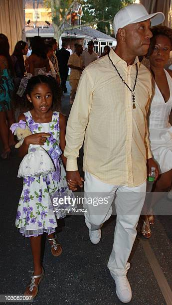 Russell Simmons and Aoki Lee Simmons attend the 11th annual Art For Life benefit party at Russell Simmons' East Hampton Estate on July 24 2010 in...