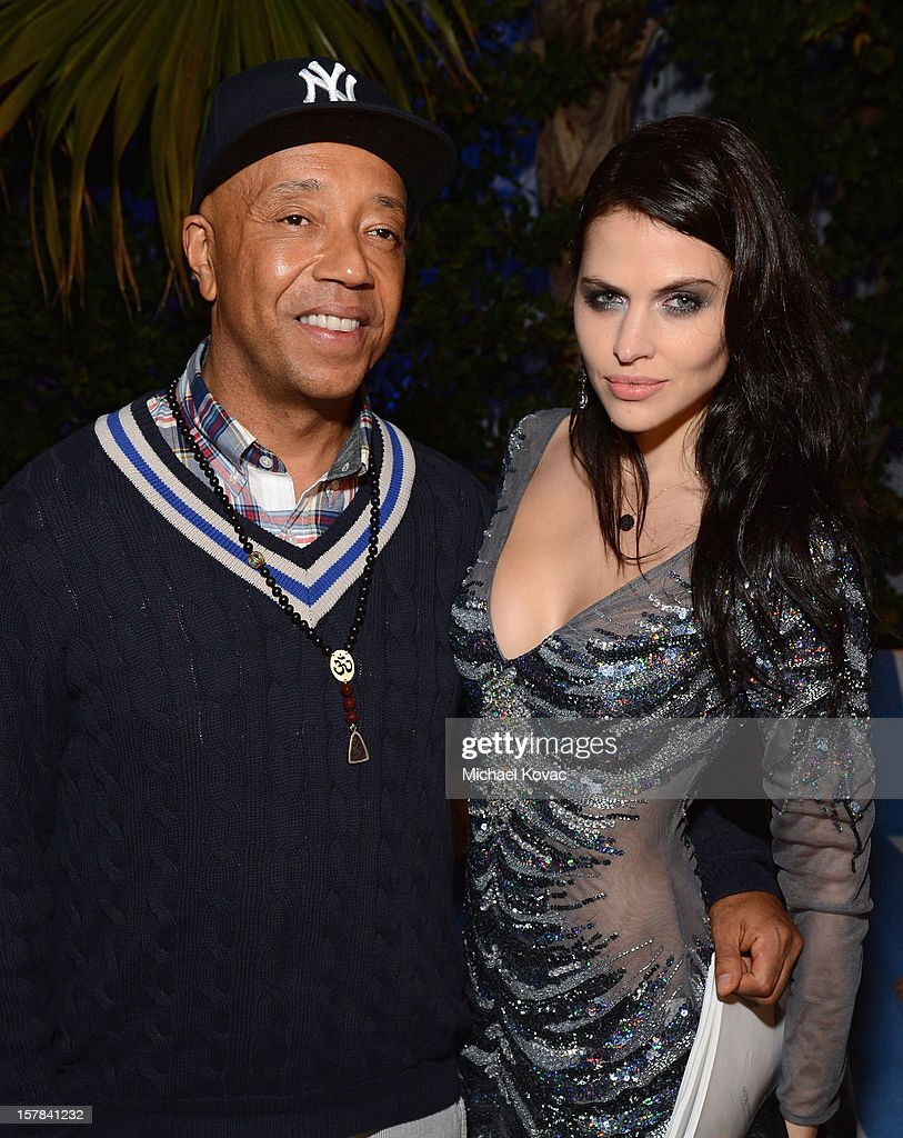 Russell Simmons and Hana Nitsche attend a LACOSTE + CAMPANAS Celebration during Art Basel Miami Beach at Soho Beach House on December 6, 2012 in Miami Beach, Florida.