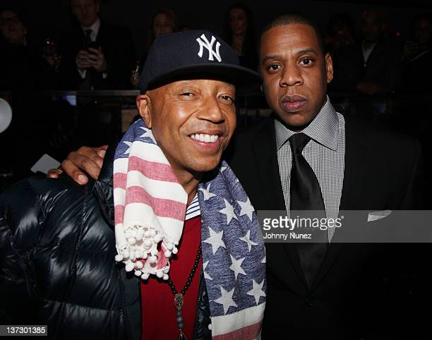 Russell Simmons and JayZ attend the grand reopening of JayZ's 40/40 Club on January 18 2012 in New York City