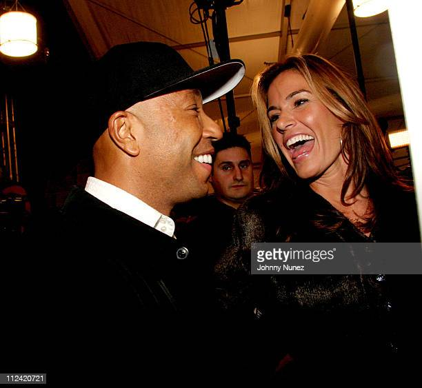 Russell Simmons and Kelly Killoren Bensimon during Olympus Fashion Week Fall 2006 Baby Phat Front Row and Backstage at Bryant Park in New York City...