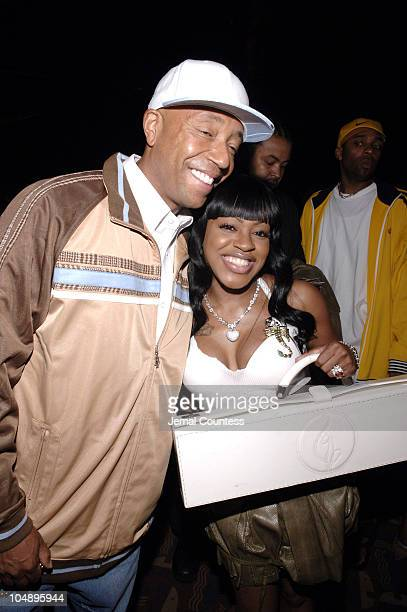 Russell Simmons and Lil Mo during Olympus Fashion Week Spring 2006 Baby Phat Front Row and Backstage at Radio City Music Hall in New York City New...
