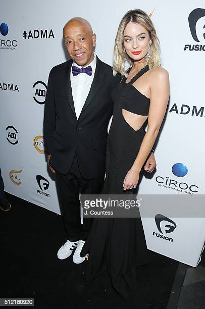 Russell Simmons and Lucy McIntosh attend the All Def Movie Awards at Lure Nightclub on February 24 2016 in Los Angeles California
