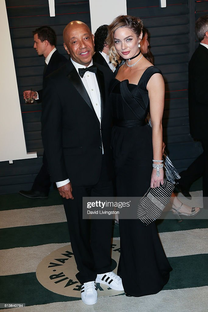 Russell Simmons and model Lucy McIntosh arrive at the 2016 Vanity Fair Oscar Party Hosted by Graydon Carter at the Wallis Annenberg Center for the Performing Arts on February 28, 2016 in Beverly Hills, California.
