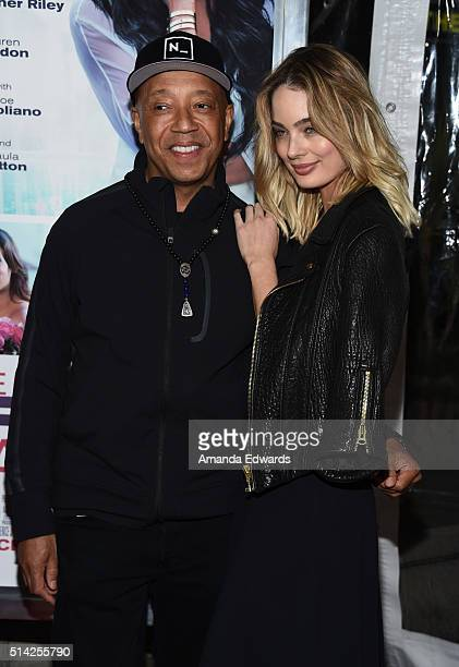 Russell Simmons and model Lucy McIntosh arrive at the premiere of Lionsgate's The Perfect Match at ArcLight Hollywood on March 7 2016 in Hollywood...